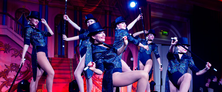dancers wearing top hats and tails