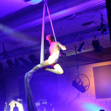 aerialists performing with silks at an event