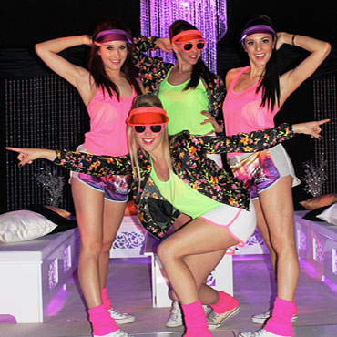 80s themed dancers at a nightclub event