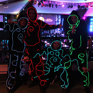 LED dancers in black costumes at a corporate event
