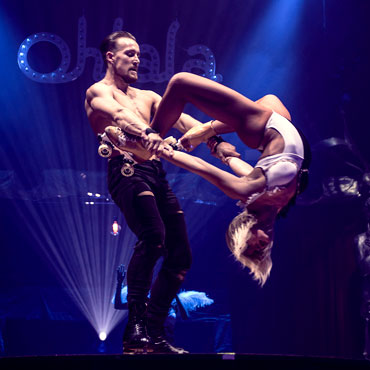 male and female acro-skate duo performing on stage