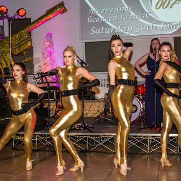 dancers at a james bond themed event