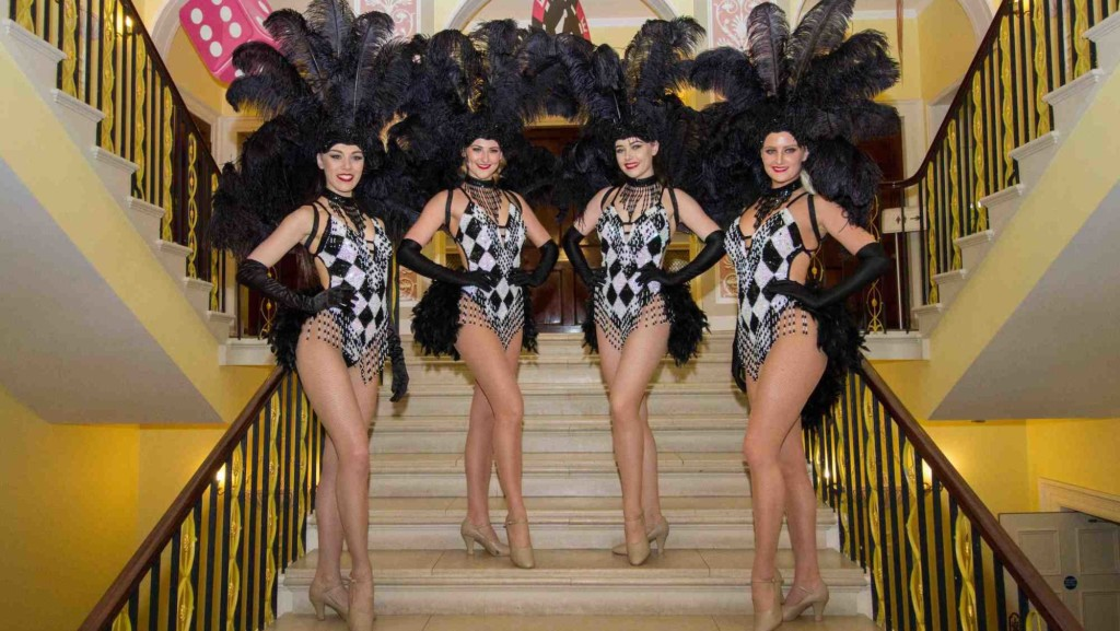 Black and white showgirls at luxury event